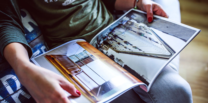 A woman reading an architectural catalog.
